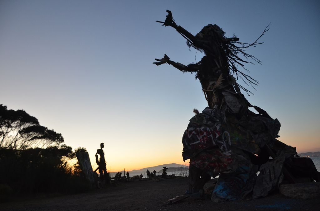 Image of a wood and metal sculpture against a sunset at the Albany Bulb.
